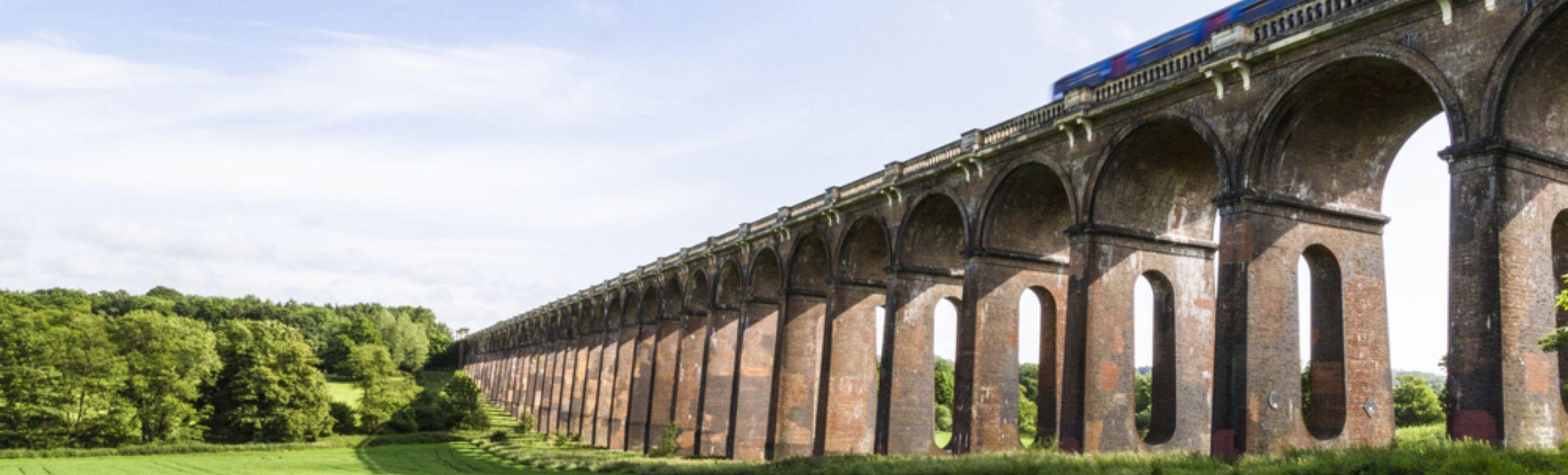 Modern train crossing a viaduct