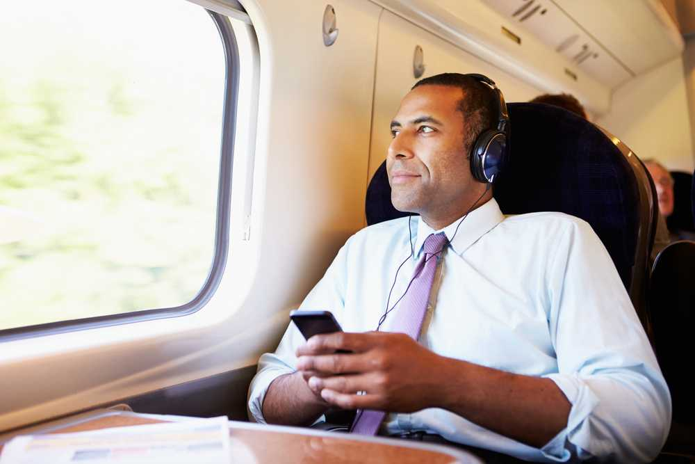 Man listening to music on train
